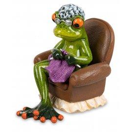 Frosch Oma strickend auf Sessel